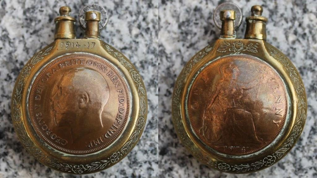 British lighter made of two penny coins and a cartridge