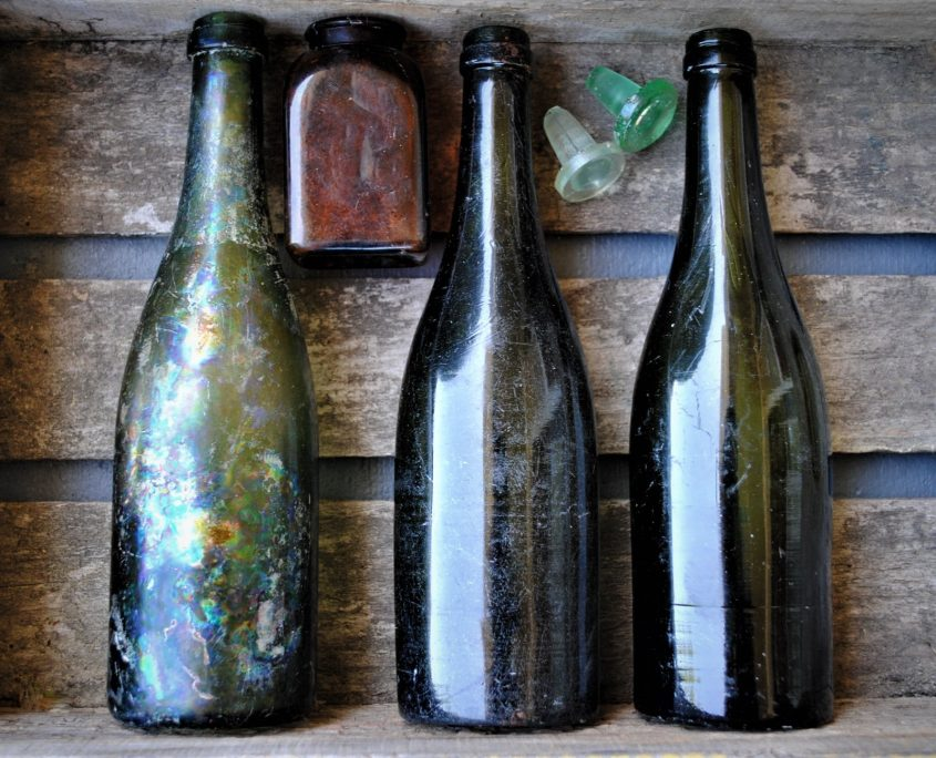Three champagne bottles and a snuff bottle recovered in the upper layers of the privy